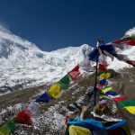 Beautiful manaslu base camp and Tibetian prayer flag,Astounding Mountain landscape with blue sky from the Manaslu Base Camp(4400m)- manaslu circuit trek.
