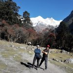 Panoramic view of Snow covered Himalaya mountains with beautiful sunny days along with ladies trekkers on the way to Manaslu circuit-Manaslu circuit trek.