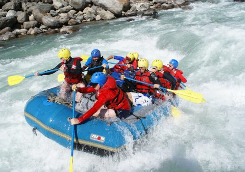 Rafting participants forwarding paddle in marsyangdi river rafting, Nepal.