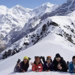Amazing guest and guide pose viewing Gangapurna mountain on North Nepal's Mardi Himal Trek 9 days package