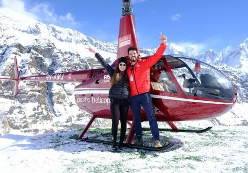 Happy couple enjoying the sightseeing on the way to Annapurna and gangapurna- Annapurna base camp helicopter tour